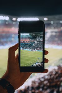 taking a photo 200x300 - How to Attend the UEFA Euro 2020 - Tips and Tricks for Watching the Upcoming European Championship Live